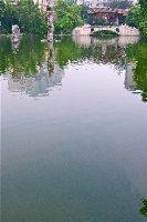 Liang Garden central lake and distant bridge pavilion