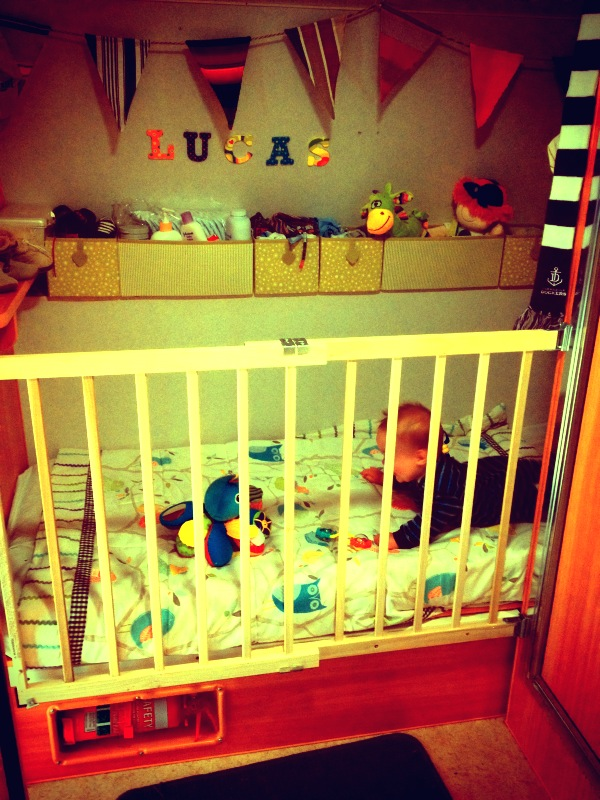 Lucas playing in his cot
