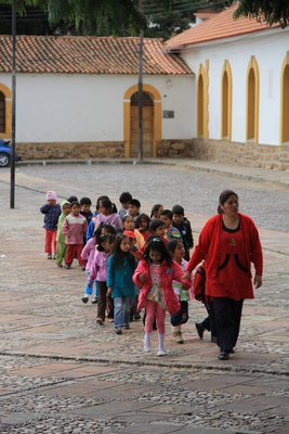 School children walking across the square