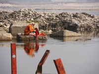 Haridwar_A sadhu washing his clothes in the Ganges
