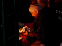 Haridwar_devotions in a dark doorway