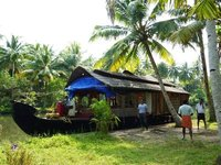 Our kettuvallam (houseboat) at one of the stops