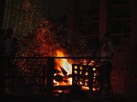 Varanasi_Manikarnika Ghat - A Dom pokes a funeral pyre