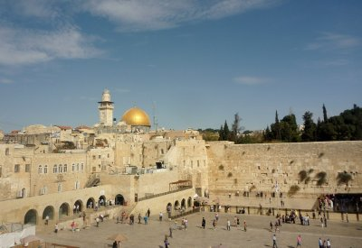 The Western Wall, with the Dome of the Rock seen behind