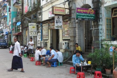 Tea house life, Yangon. Note the child-sized plastic chairs and tables