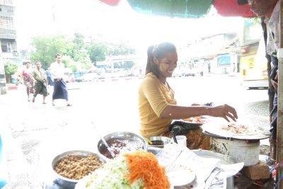 Street food vendor, sandalwood paste on her face, Yangon