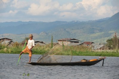 The unusal style of rowing used by the people of Inlay Lake