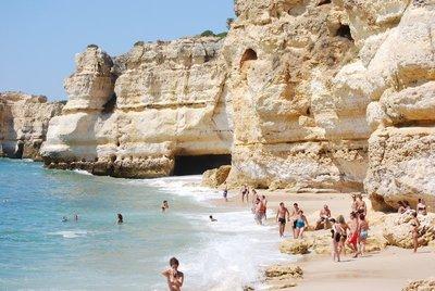Albufeira, Praia da Coelha, view along the beach to a deep cave