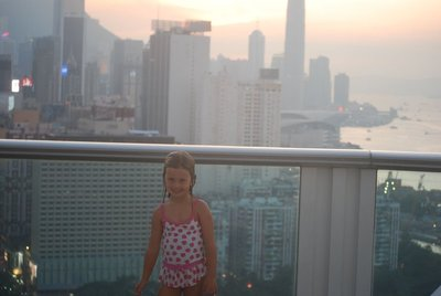 Nat poolside in our hotel ... Causeway Bay and Wan Chai behind