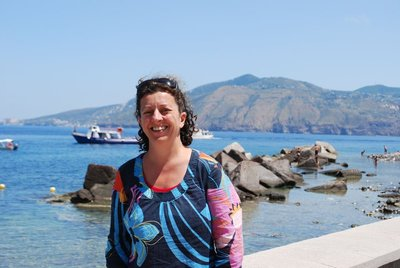 Lisa looking content after lunch in Lingua, Salina (Lipari in the background)