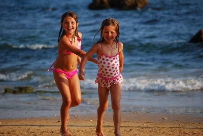 Olhos d'Agua, girls stretching out on Praia d'Agua