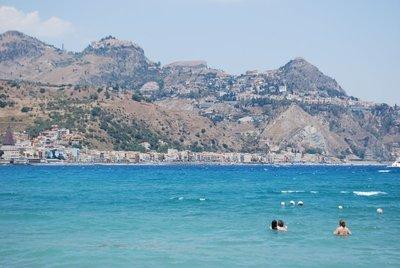 looking up to Taormina from the bay of Giardini Naxos