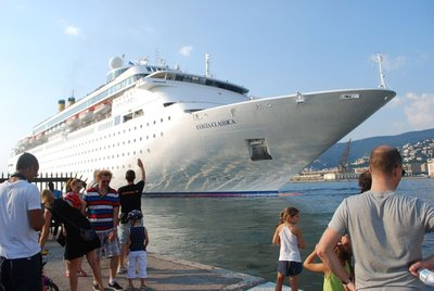 the new Costa ... one of many cruise ships through the busy port