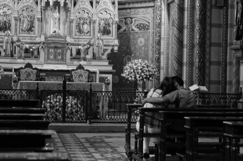 Couple praying inside the cathedral