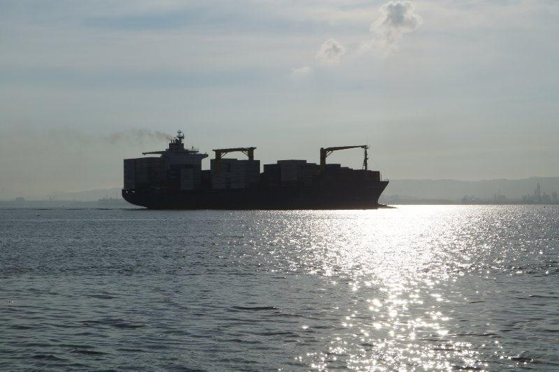 A cargo ship exiting the bay