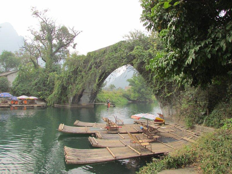 Dragon bridge and some bamboo rafts