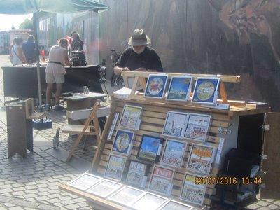 A Street Artist selling his paintings in Copenhagen
