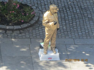 Street performer posing like a statue