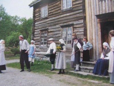 PEOPLE IN PERIOD COSTUME AT AN 1820 BUILDING (NOW A FOLK MUSEUM)