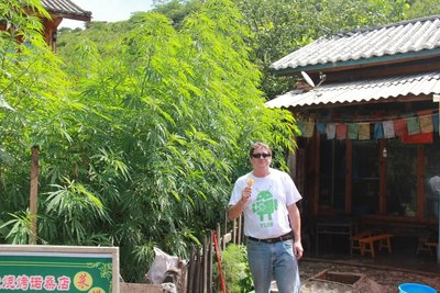 Lige - Jeremy in front of one of the shops