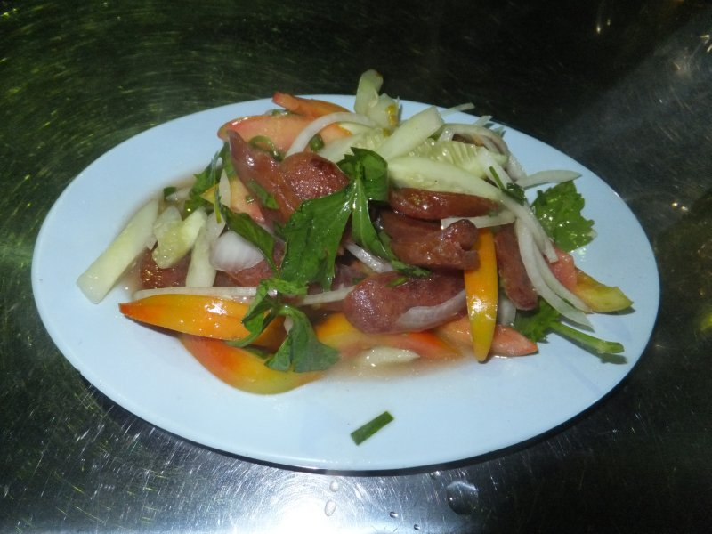 Street food in Krabi Thailand - Spicy Thai salad with Chinese Sausage.