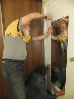 Hanging a New Mirror at Matthew House