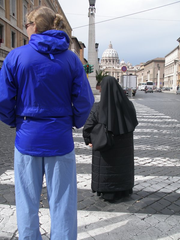 Nadine towers over the short nuns