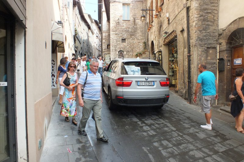 cars and pedestrians share the road