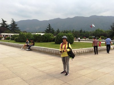 At the entrance of the Terra Cotta Museum with Qin Ling Mountain at the background.