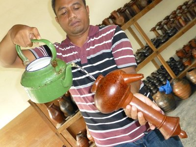Lombok marvelous pottery. Water is poured from the bottom hole and poured out through the snout.