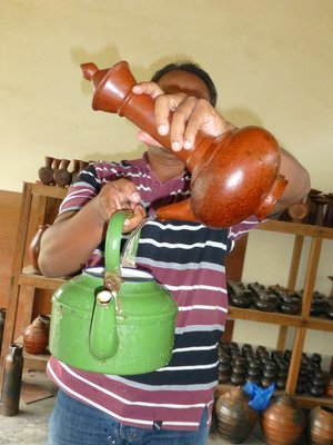 Pak Hakim demonstrate how the po, Kendi Maling, t works at Lombok pottery at Banyumulak.