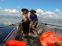 Us in Chinese hats, rowing the boat (or pretending to at least!)