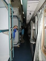 Tam in the hard sleeper carriage (looking less than impressed!)