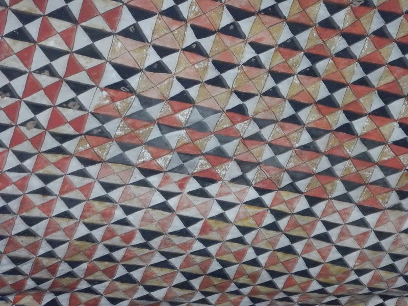 Intricate design on the cave ceiling in Dambulla