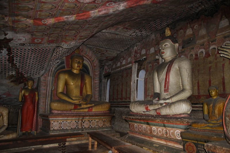 Some of the many statues in a dark corner of Cave 2 Dambulla
