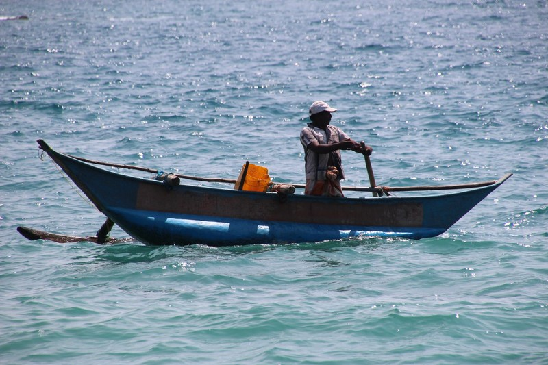 Fisherman in a traditional boat