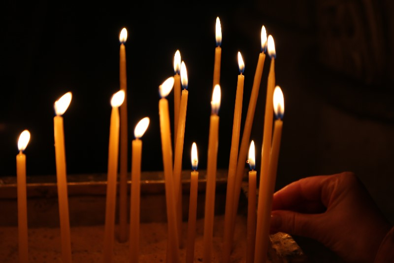 Placing Candles inside the Church of the Sepulchre, Jerusalem