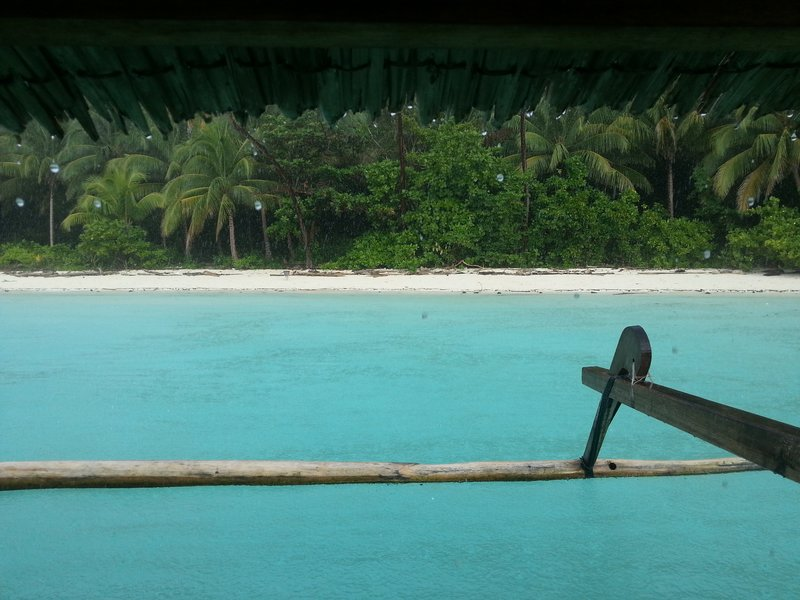 tropical rain. view from boat on snorkeling trip
