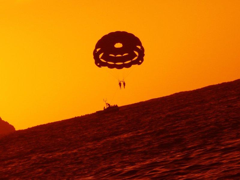 Hang gliding at sunset.