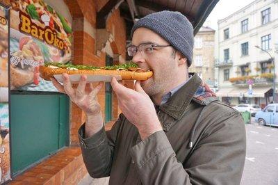 Andrew eating a zapiekankas