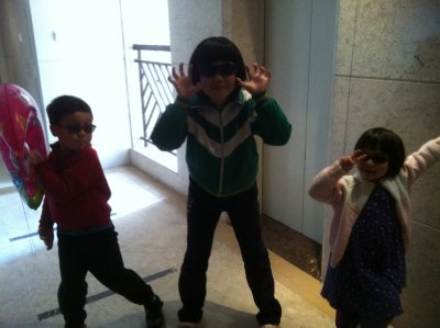cousins waiting for the elevator to go down