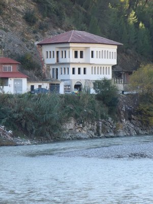 Large house by the river.