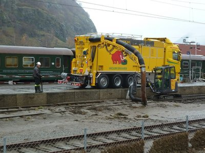Clean up underway in Flam sucking up all the silt