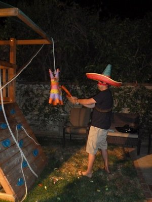 Party Time - trying to break open the Pinata by hitting it with a bat