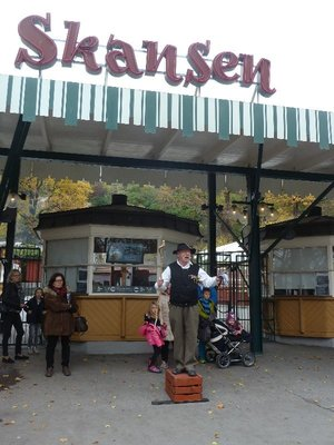 A colourful local on his soapbox welcoming visitors at the entrance to Skansen