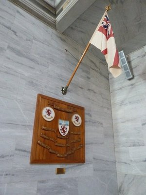 Flag and plaque in the Radhuset Great Hall for HMS Devonshire who returned King Haakon VII to Oslo in May 1945