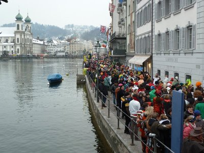 Rathausquai during the Carnival with the Jesuit Church on the other side of the river