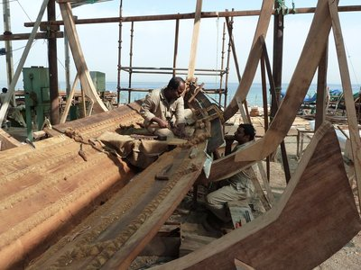 Stitching a boat's planks together the traditional way