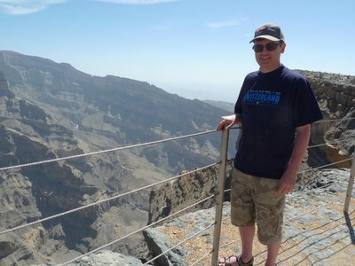 Me next to the canyon edge at Jebel Shams