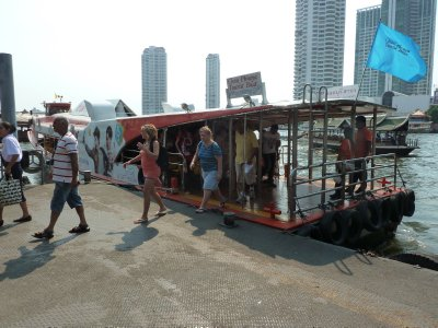 Getting off the ferry at Saphran Taksin